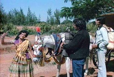 Hema Malini, Dharmendra and Amitabh Bachchan in Sholay